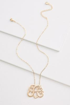 a scroll gold necklace