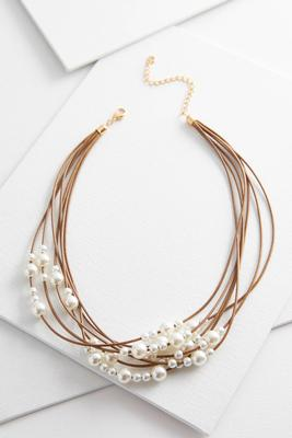 layered cord and pearl necklace