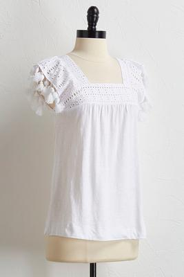 pom-pom and tassel eyelet top