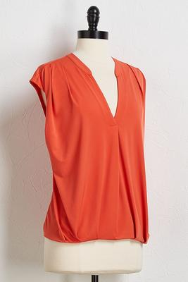 orange blouson top