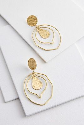 worn gold statement earrings
