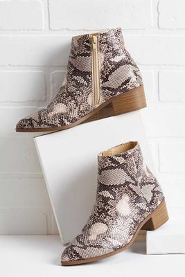 slithering snakeskin boots
