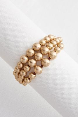 worn gold beaded bracelet