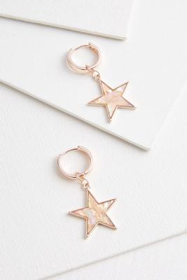 a star is worn earrings
