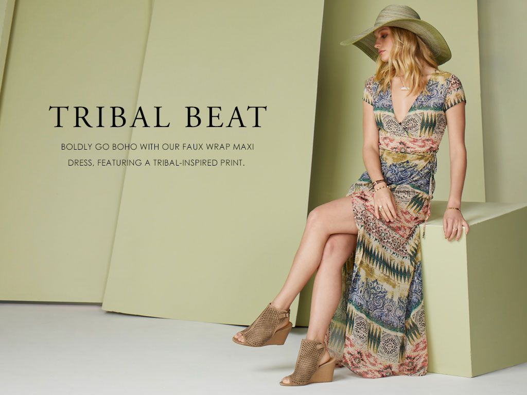 Tribal Beat- boldly go boho with our faux wrap maxi dress, featuring a tribal-inspired print.