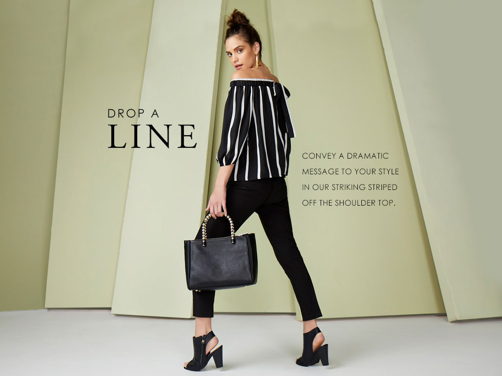 Add a line- Convey a dramatic message to your style in our striking striped off the shoulder top.